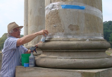 Worker feeding Voidspan PHL grout into a column base